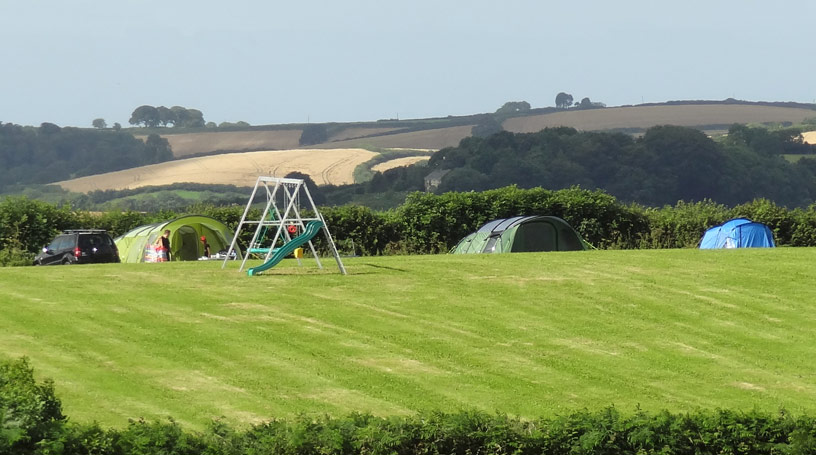 Photo of campsite with Dartmoor in the distance